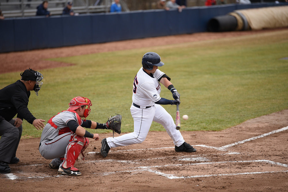 First baseman Tyler Gnesda takes a swing in the UConn Huskies' home opener against the Hartford Hawks at J.O. Christian Field on Wednesday, April 5, 2017. The Huskies lost the game 6-4.(Zhelun Lang/ The Daily Campus)