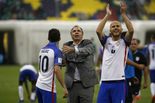 United States coach Bruce Arena, center, celebrates with Christian Pulisic, left, as Michael Bradley salutes supporters after a 1-1 draw in a World Cup qualifying match at Azteca Stadium in Mexico City Sunday. (Eduardo Verdugo/AP)