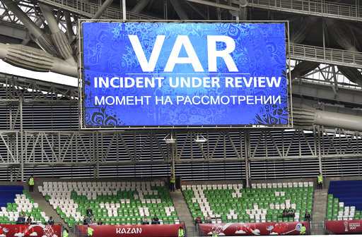 A giant screen reports a VAR incident is being reviewed during the Confederations Cup, Group A soccer match between Portugal and Mexico, at the Kazan Arena, Russia, Sunday, June 18, 2017. (Martin Meissner/AP)