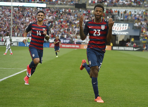 United States' Kellyn Acosta celebrates his goal against Ghana as teammate United States' Dom Dwyer smiles behind him during an international friendly soccer match at Pratt & Whitney Stadium at Rentschler Field, Saturday, July 1, 2017, in East Hartford, Conn. The USA won 2-1. (Jessica Hill/AP)
