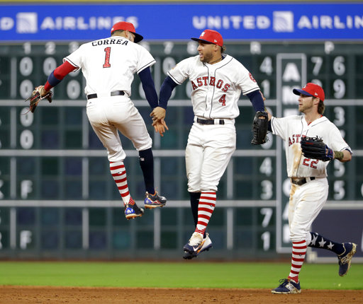 Houston Astros' Carlos Correa (1), George Springer (4) and Josh Reddick (22) celebrate after the team's baseball game against the New York Yankees on Saturday, July 1, 2017, in Houston. The Astros won 7-6. (AP Photo/David J. Phillip)