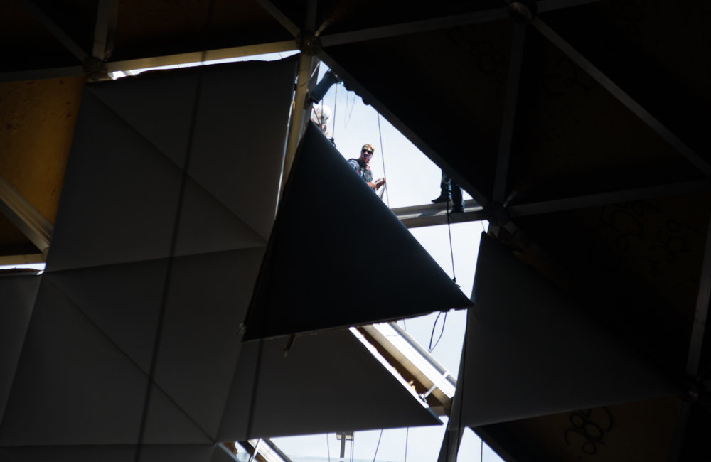 UDPC workers raise a newly covered ceiling tile into place on July 26, 2017. (Amar Batra/The Daily Campus)