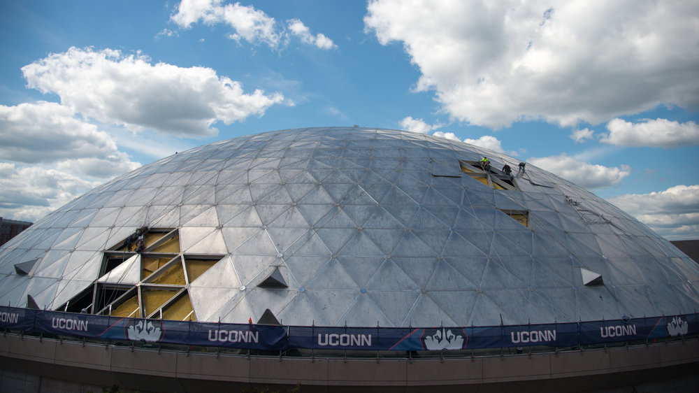 The outside dome of Gampel Pavilion sits in a state of construction on Wednesday, July 26, 2017 as University Planning, Design and Construction works to fix the old roof. (Amar Batra/The Daily Campus)
