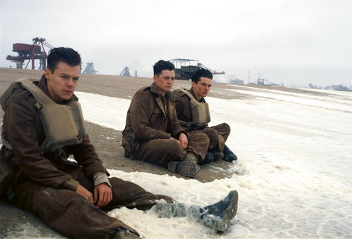 "This image released by Warner Bros. Pictures shows Harry Styles, from left, Aneurin Barnard and Fionn Whitehead in a scene from ""Dunkirk."" (Warner Bros Pictures via AP)"