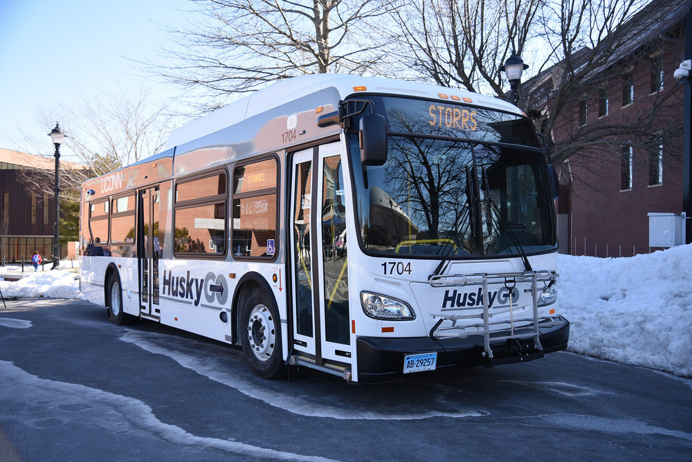 The transportation department shows off the new buses on Fairfield Way. The new bus service will make several stops around the Storrs campus, including at Whitney Hall and Storrs Center along Route 195. (Charlotte Lao/The Daily Campus)