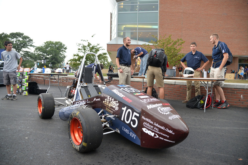 Members of the Formula SAE team show off their car and attract new members during the fall 2016 involvement fair. Formula SAE is one of the hundreds of interesting clubs that students can join. (Amar Batra/The Daily Campus)