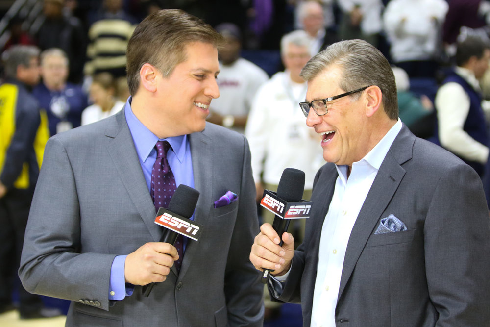 Head coach Geno Auriemma being interviewed by ESPN's Steve Levy after the Huskies reached their 100th consecutive win. (Jackson Haigis/The Daily Campus)