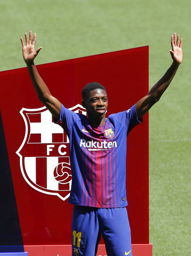 FC Barcelona's new signing Ousmane Dembele gestures during his official presentation at the Camp Nou stadium in Barcelona, Spain, Monday, Aug. 28, 2017. Barcelona is shoring up its attack following Neymar's departure by buying Ousmane Dembele from Borussia Dortmund in a deal that could reach 147 million euros (about US dollars 173 million). (AP Photo/Manu Fernandez)