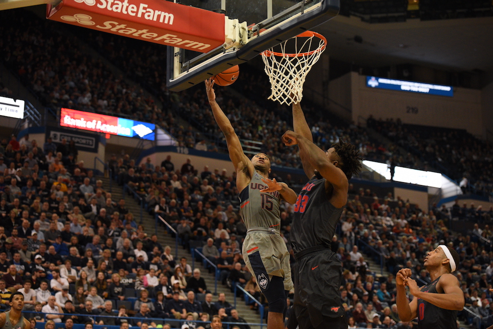 Former UConn guard Rodney Purvis , left, about to dunk during a game. (File Photo/The Daily Campus)