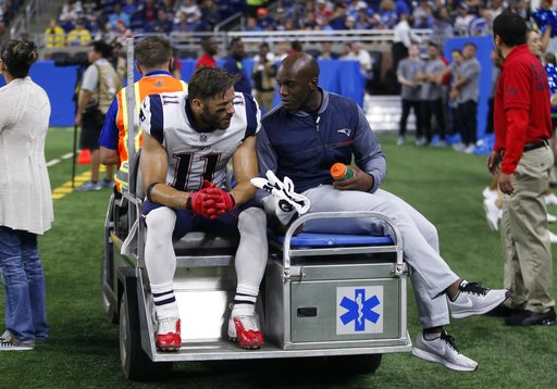 New England Patriots wide receiver Julian Edelman (11) is taken off the field on a cart during the first half of an NFL preseason football game against the Detroit Lions, Friday, Aug. 25, 2017, in Detroit. (AP Photo/Duane Burleson)