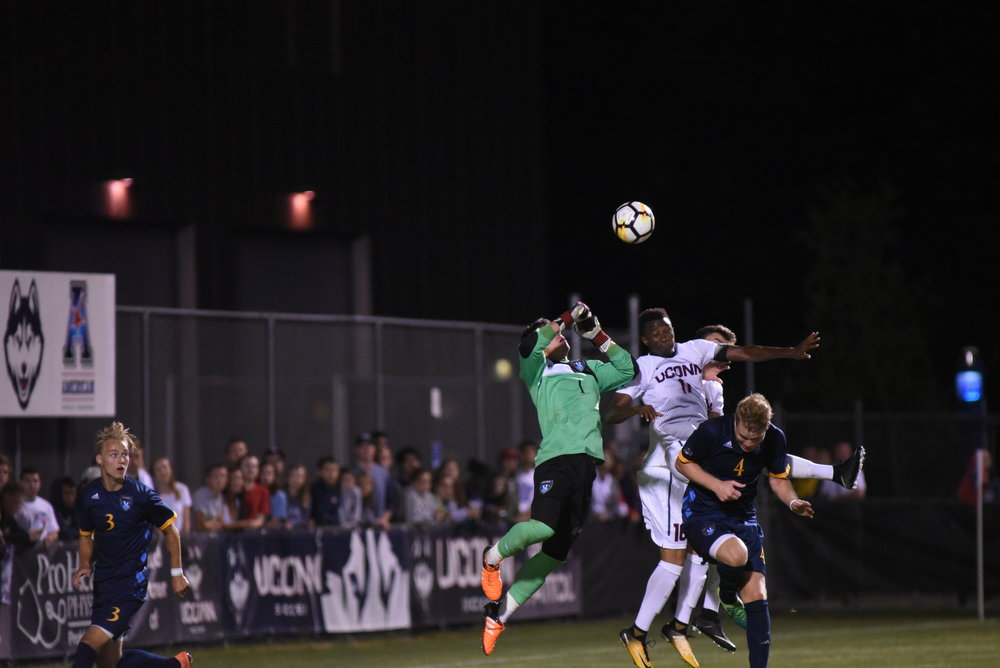 UConn's Abdoue Mbacke Thiam (#11) attempts a header during Monday's match against Quinnipiac. Thiam would end up scoring the game-winner in overtime. (Charlotte Lao/The Daily Campus)