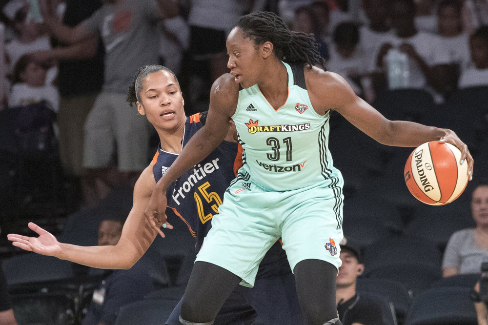 This July 19, 2017, file photo shows New York Liberty center Tina Charles (31) driving to the basket against Connecticut Sun forward Alyssa Thomas (25) during the first half of a WNBA basketball game, at Madison Square Garden in New York. (Mary Altaffer/AP)