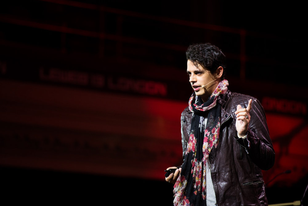 In this photo of Milo Yiannopoulos, he is seen giving one of his numerous political speeches (@Kmeron/Flickr, Creative Commons)