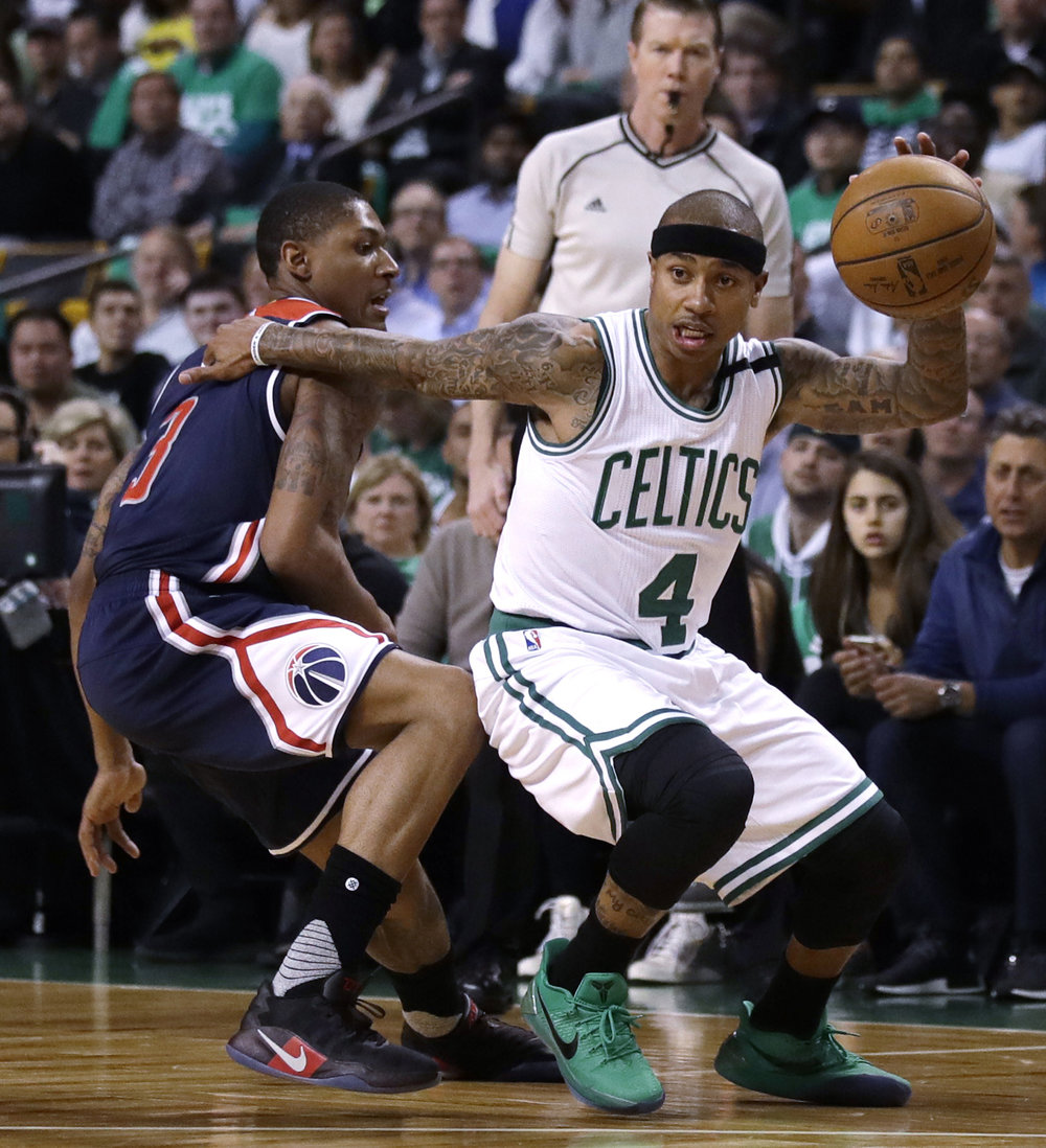 This May 10, 2017, file photo shows Boston Celtics guard Isaiah Thomas (4) driving to the basket during the first quarter of a second-round NBA playoff series basketball game in Boston. He's now bound for Cleveland in exchange for what the Celtics believe is a bigger star, and better point guard, in Kyrie Irving. (Charles Krupa/AP)