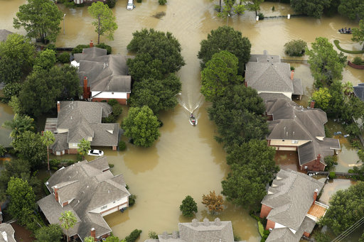 Floodwaters from the Addicks Reservoir inundate a neighborhood off N. Eldridge Parkway in the aftermath of Tropical Storm Harvey on Wednesday, Aug. 30, 2017, in Houston. (Brett Coomer/Houston Chronicle via AP)