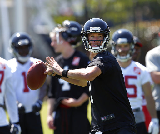 This June 15, 2017, file photo shows Atlanta Falcons quarterback Matt Ryan (2) throwing a pass during NFL minicamp football in Flowery Branch, Ga. (AP Photo/John Bazemore, File)