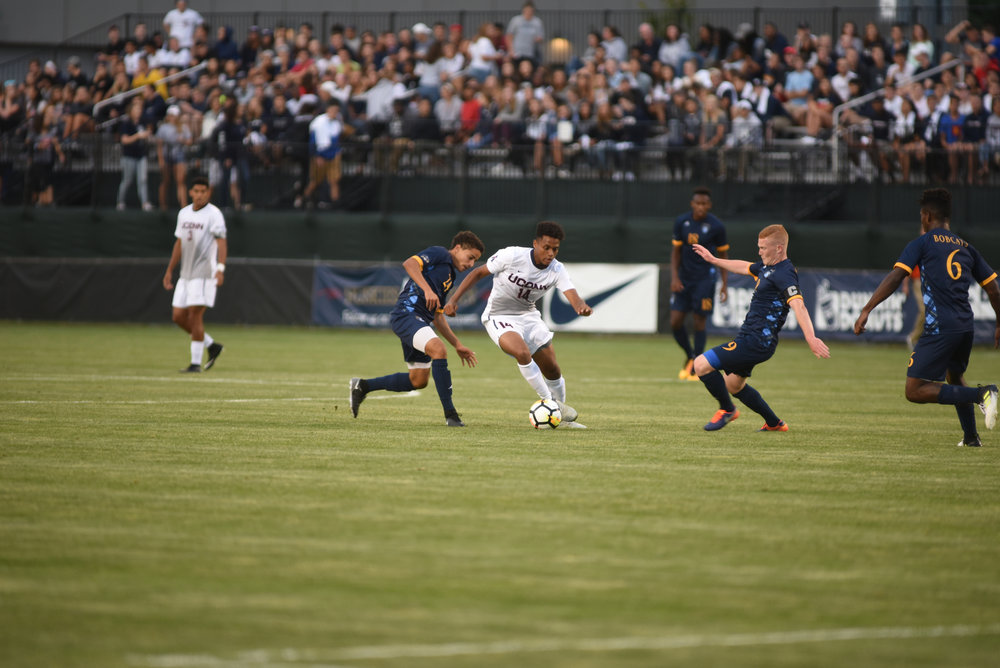 UConn midfielder Munir Saleh avoids Quinnipiac defenders during the Huskies 1-0 overtime victory over the Bobcats on Monday, Aug. 28, 2017. The Huskies hope to improve on the poor start to the season. (Charlotte Lao/The Daily Campus)
