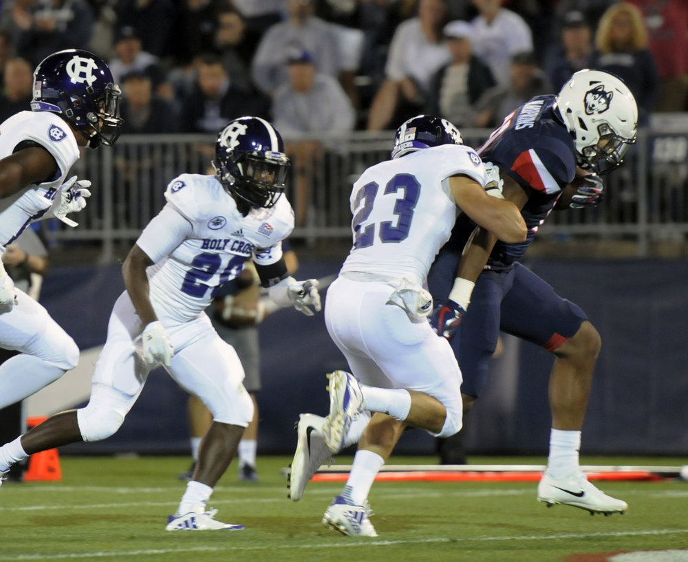Connecticut running back Nate Hopkins, right, scores in the second quarter of an NCAA college football game against Holy Cross, Thursday, Aug. 31, 2017, in East Hartford, Conn. (Stephen Dunn/AP)