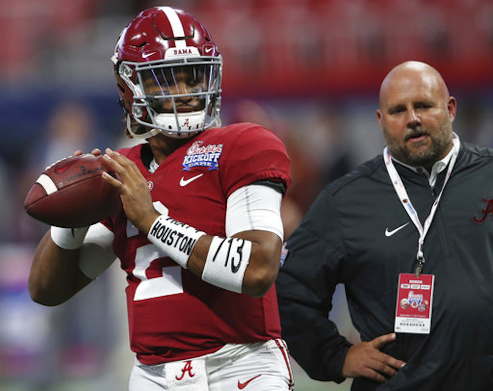 "Alabama quarterback Jalen Hurts (2) warms up wearing arm bands stating ""Pray for Houston,"" before the first half of an NCAA football game between Alabama and Florida State, Saturday, Sept. 2, 2017, in Atlanta. (AP Photo/John Bazemore)"
