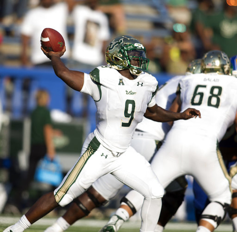 South Florida quarterback Quinton Flowers (9) winds up to pass against San Jose State during the second quarter of an NCAA college football game, Saturday, Aug. 26, 2017, in San Jose, Calif. (AP Photo/D. Ross Cameron)
