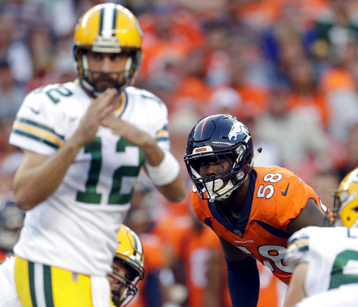 FILE - In this Aug. 26, 2017, file photo, Denver Broncos outside linebacker Von Miller (58) watches as Green Bay Packers quarterback Aaron Rodgers (12) calls time out during the first half of an NFL preseason football game, in Denver. The Broncos begin their season on Sept. 10 against the Los Angeles Chargers. (AP Photo/Joe Mahoney, File)