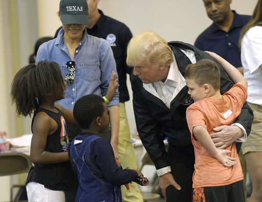 President Donald Trump and Melania Trump meet people impacted by Hurricane Harvey during a visit to the NRG Center in Houston, Saturday, Sept. 2, 2017. (AP Photo/Susan Walsh)