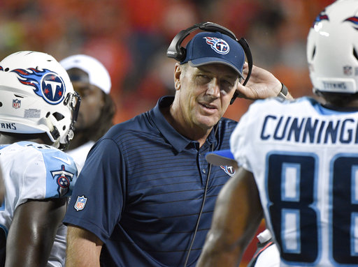 Tennessee Titans head coach Mike Mularkey removes his headset during the first half of an NFL preseason football game against the Kansas City Chiefs in Kansas City, Mo., Thursday, Aug. 31, 2017. (AP Photo/Ed Zurga)
