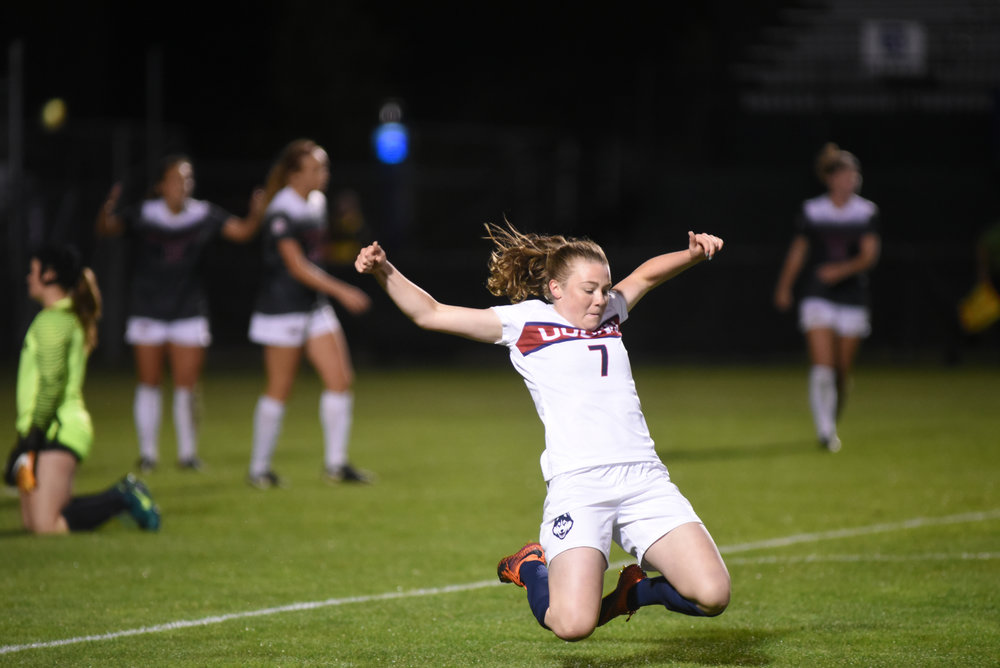 Freshman forward Kess Elmore slides to the ground following her overtime goal against Razorbacks on Sept. 7, 2017 at Morrone Stadium. Connecticut defeated Arkansas 2-1. (Charlotte Lao/The Daily Campus)