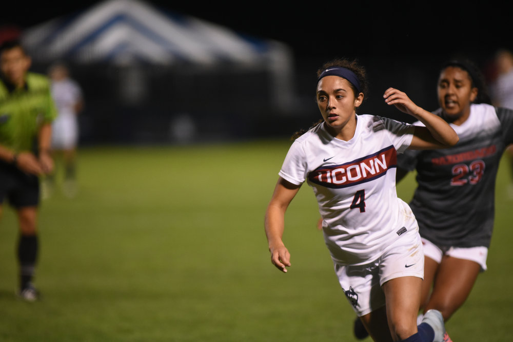 Sophomore midfielder Alexa Casimiro speeds down the field during the Huskies 2-1 overtime victory over the the Razorbacks on Thursday, Sept. 7, 2017. Casimiro scored the first goal for the Huskies. (Charlotte Lao/The Daily Campus)