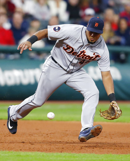 Detroit Tigers' Jeimer Candelario fields and throws out Cleveland Indians' Yandy Diaz at first base during the third inning in a baseball game, Monday, Sept. 11, 2017, in Cleveland. (AP Photo/Ron Schwane)
