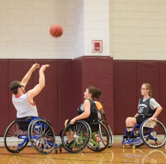 Students in the adaptive sports program enjoy a game of basketball. (Courtesy/Antonio Salazar)