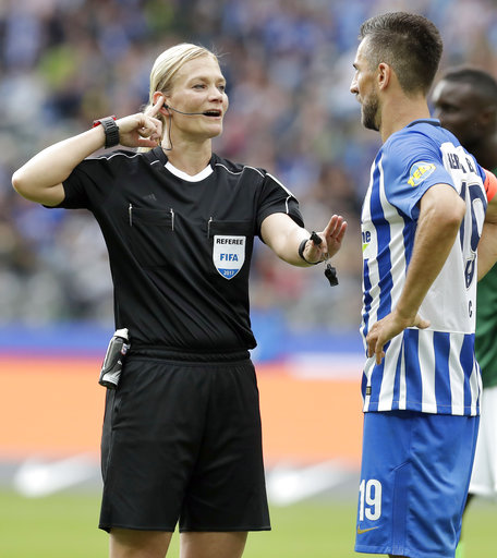 Referee Bibiana Steinhaus, left, speaks to a player during the German Bundesliga soccer match between Hertha BSC Berlin and SV Werder Bremen in Berlin, Germany, Sunday, Sept. 10, 2017. (AP Photo/Michael Sohn)