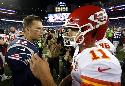 New England Patriots quarterback Tom Brady, left and Kansas City Chiefs quarterback Alex Smith, right, speak at midfield after an NFL football game, early Friday, Sept. 8, 2017, in Foxborough, Mass. (AP Photo/Steven Senne)