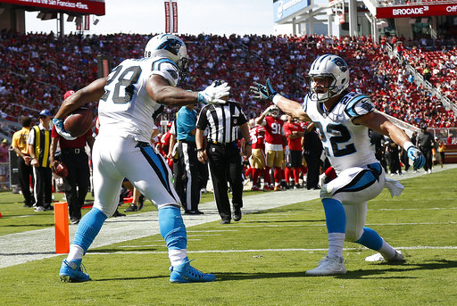 Carolina Panthers running back Jonathan Stewart (28) celebrates after scoring a touchdown with running back Christian McCaffrey during the second half of an NFL football game against the San Francisco 49ers in Santa Clara, Calif., Sunday, Sept. 10, 2017. (AP Photo/Tony Avelar)