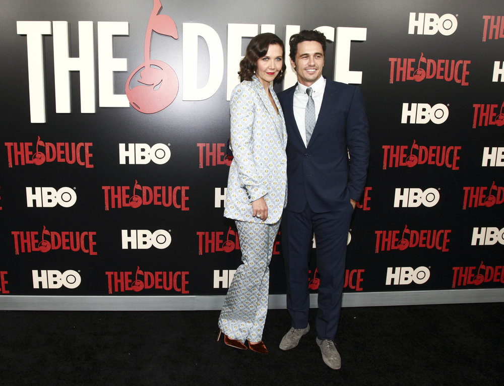 "Maggie Gyllenhaal, left, and James Franco, right, attend the premiere of the HBO Original Series ""The Deuce"" at the SVA Theatre on Thursday, Sept. 7, 2017, in New York. (Andy Kropa/Invision/AP)"