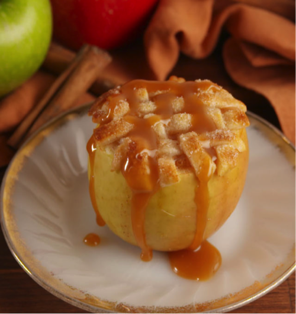 This week's recipe puts a creative twist on the most classic apple dish of all time: Apple pie. Instead of pie crust, it's apple pie filling baked right into an apple with a crust on top. (Screenshot from Delish.com)