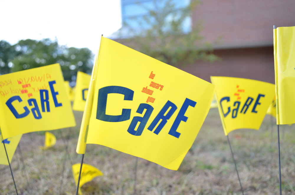Students write notes on the back of Care flags in front of the Student Union for National Suicide Awareness Month. (File Photo/The Daily Campus)