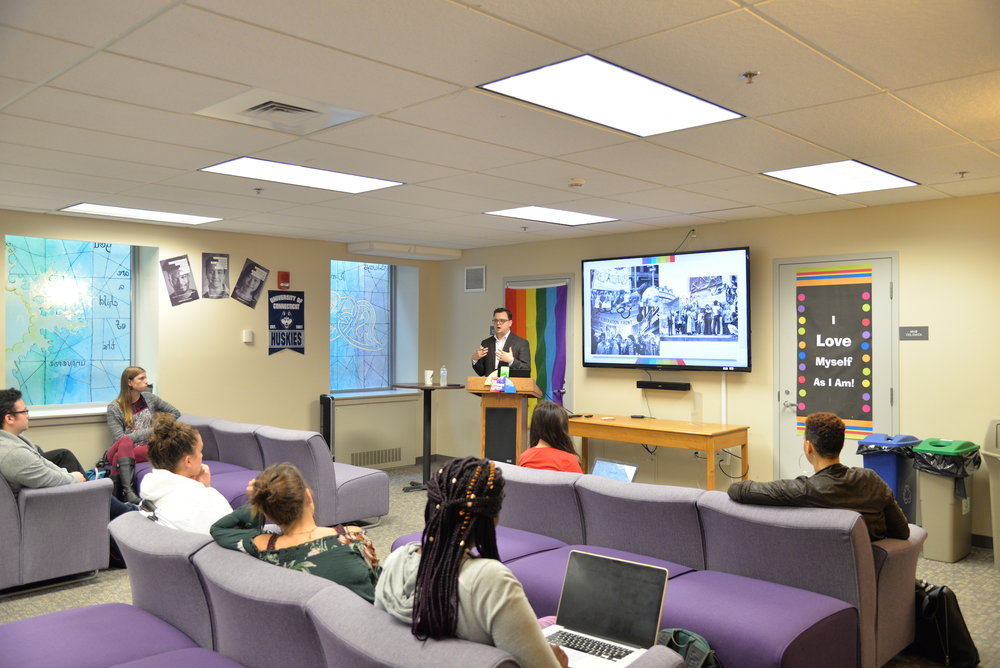 Brian Edwards, the new director of the Rainbow Center, gives a lecture talking about the history of LGBTQ centers in colleges on Wednesday, Sept. 20, 2017 in the Rainbow Center. (Amar Batra/The Daily Campus)