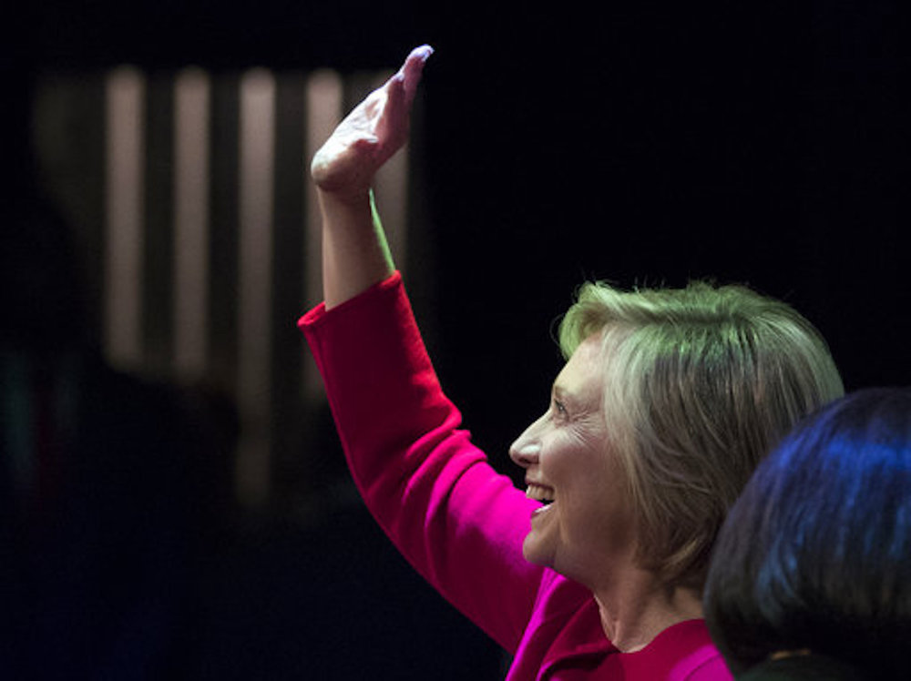 "Hillary Clinton waves to the audience at the Warner Theatre in Washington, Monday, Sept. 18, 2017, for book tour event for her new book ""What Happened"" hosted by the Politics and Prose Bookstore. (AP Photo/Carolyn Kaster)"