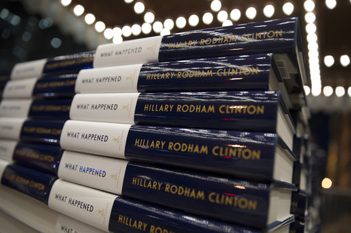 """Stacks of Hillary Clinton's book """"What Happened"""" are staged outside the Warner Theatre in Washington, Monday, Sept. 18, 2017, as Clinton participates in a book tour event hosted by the Politics and Prose bookstore. (AP Photo/Carolyn Kaster)"""