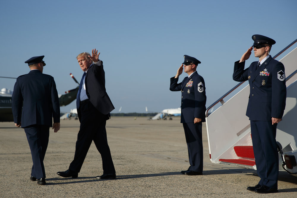 President Donald Trump waves to reporters after stepping off Air Force One after arriving at Andrews Air Force Base, Sunday, Sept. 24, 2017, in Andrews Air Force Base, Md. (AP Photo/Evan Vucci)