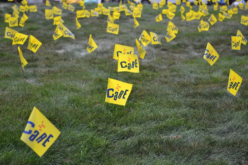"During Suicide Prevention Week, from Sept. 25 through Sept. 29, the lawn in front of the Student Union is serving as a ""Field of Memory."" To give students a way to visualize the impact suicide has on communities, one thousand yellow flags are stuck in the ground to represent all the lives lost. (Olivia Stenger/The Daily Campus)"
