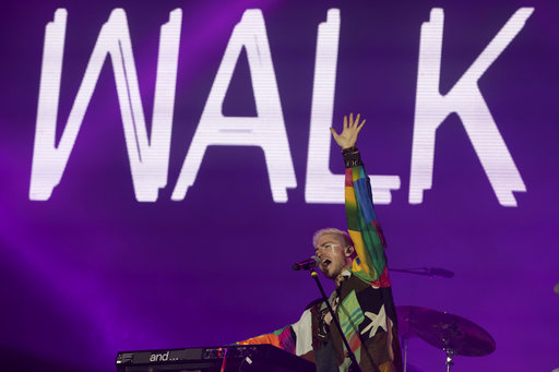The Nicholas Petricca of the band Walk the Moon performs at the Rock in Rio music festival in Rio de Janeiro, Brazil, Sunday, Sept. 17, 2017. (AP Photo/Leo Correa)