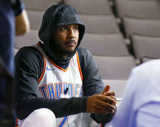 Oklahoma City Thunder forward Carmelo Anthony waits for an interview to begin during an NBA basketball media day in Oklahoma City, Monday, Sept. 25, 2017. (AP Photo/Sue Ogrocki)