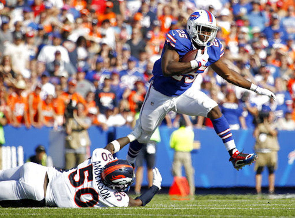 Buffalo Bills running back LeSean McCoy, top, leaves out of a tackle from Denver Broncos inside linebacker Zaire Anderson (50) during the second half of an NFL football game, Sunday, Sept. 24, 2017, in Orchard Park, N.Y. (AP Photo/Jeffrey T. Barnes)