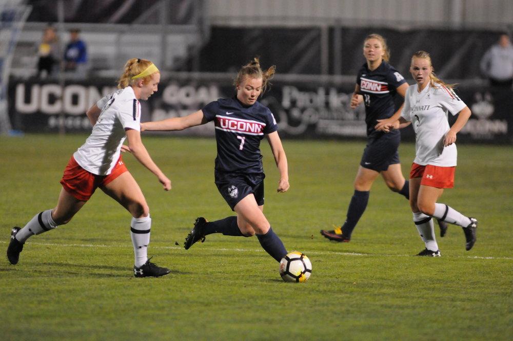 Kess Elmore (7) strikes the ball down the field inthe UConn Women's Soccer game vs. Providence on Sept. 28, 2017. (Mark Wezenski/The Daily Campus)