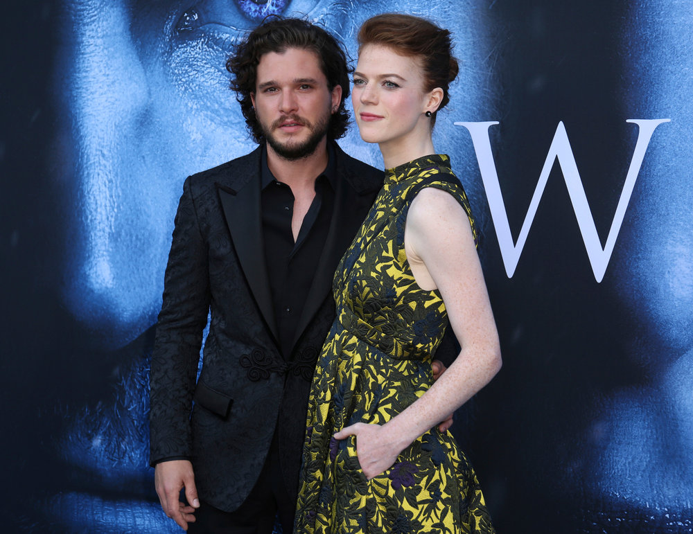 "In this July 12, 2017, file photo, Kit Harington, left, and Rose Leslie arrive at the LA Premiere of ""Game of Thrones"" at The Walt Disney Concert Hall in Los Angeles. The couple announced their engagement in the Times of London newspaper on Sept. 27, 2017. (Photo by Willy Sanjuan/Invision/AP, File)"