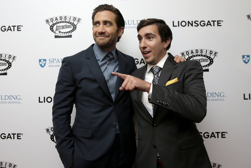 "In this Sept. 12, 2017, file photo, actor Jake Gyllenhaal, left, and Boston Marathon bombing survivor Jeff Bauman, right, arrive on the red carpet at the U.S. premiere of the movie ""Stronger"" at the Spaulding Rehabilitation Hospital, where Bauman and others who were injured in the 2013 deadly attack were treated in Boston. Gyllenhaal plays Bauman in the film, which opens Friday, Sept. 22, at theaters nationwide. (AP Photo/Steven Senne, File)"