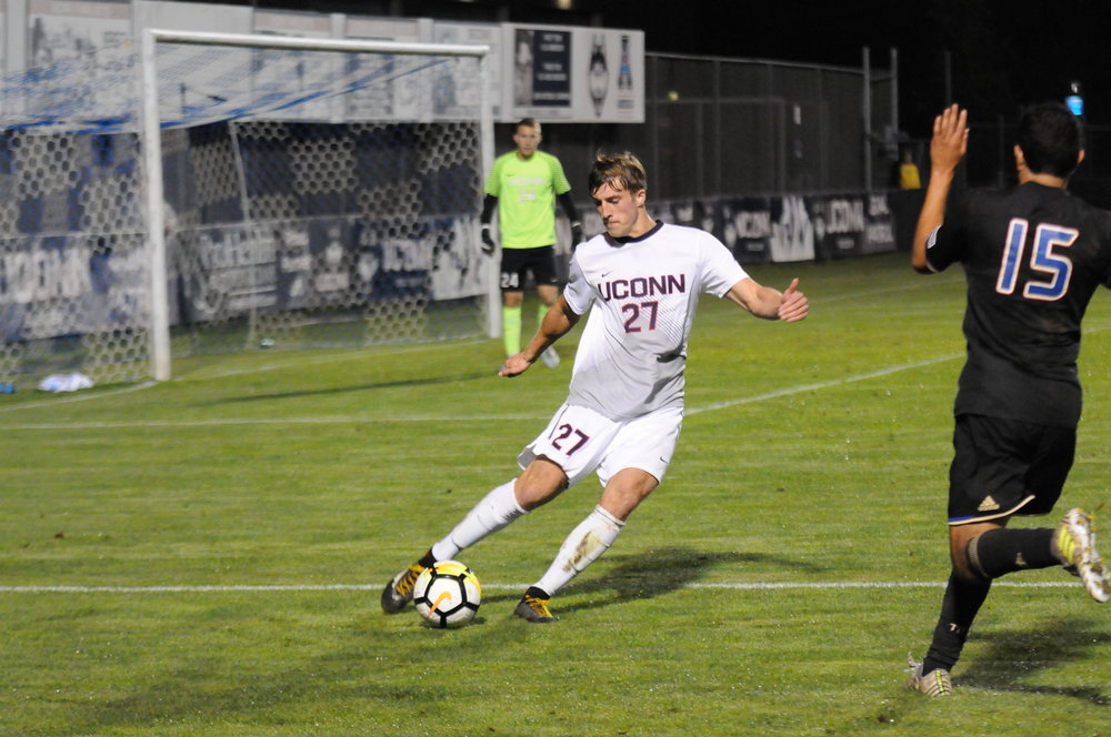 Senior defender Andrew Geres clears a ball in the Huskies last outing against Tulsa. (Nick Hampton/The Daily Campus)