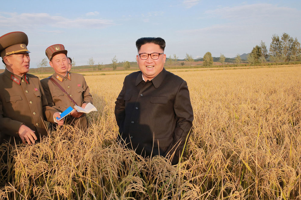 his undated photo distributed by the North Korean government on Sept. 30, 2017, shows North Korean leader Kim Jong Un, center, at a farm in North Korea. Independent journalists were not given access to cover the event depicted in this image distributed by the Korean Central News Agency via Korea News Service. The content of this image is as provided and cannot be independently verified. (Korean Central News Agency/Korea News Service via AP)